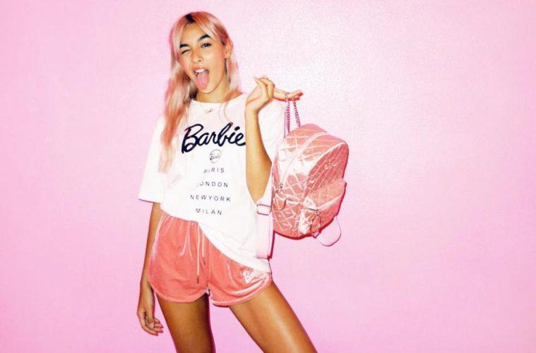 Model wears white Barbie x Missguided logo t-shirt